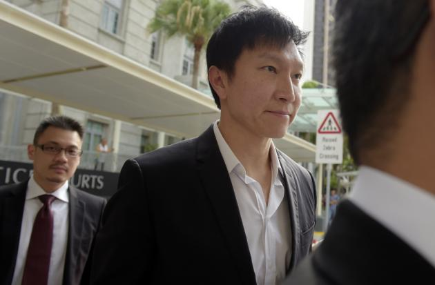 City Harvest Church founder Kong Hee arrives at court for his sentencing hearing Friday, Nov. 20, 2015 in Singapore.  The founder of the popular Singapore church was found guilty Wednesday, Oct. 21, 2015, of misappropriating about $35 million in donations to support his wife's singing career in Asia before helping her break into the U.S. market for evangelization purposes. (AP Photo/Joseph Nair)